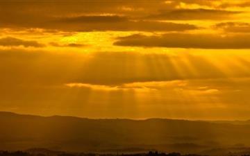 Sun Rays Through Clouds Mac wallpaper