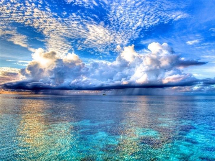 Rain clouds over the sea Mac Wallpaper