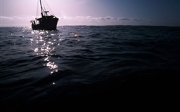 The Dark Boat On Sea Mac wallpaper