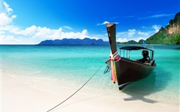 Boat on the beach Mac wallpaper