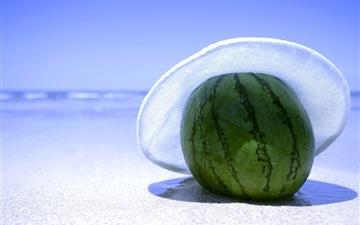 Watermelon on the beach Mac wallpaper