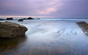 Cloudy Day And Sea Rocks Mac wallpaper