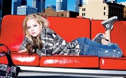 Avril Lavigne On Red Sofa Mac wallpaper