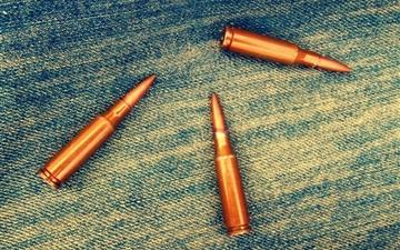 Bullets on denim Mac wallpaper