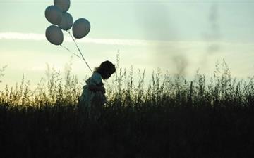 Girl With Balloons Mac wallpaper