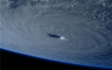 Giant Hurricane Space Mac wallpaper