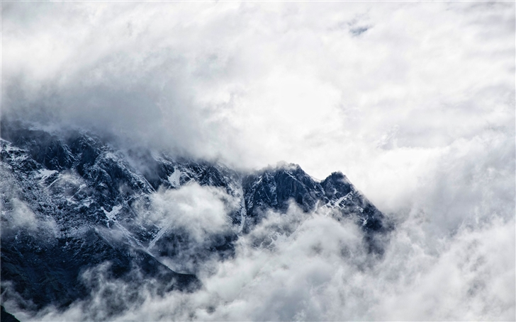Clouds over the Caucasus Mountains Mac Wallpaper