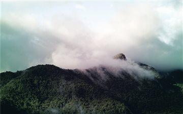Clouds on a hill Mac wallpaper