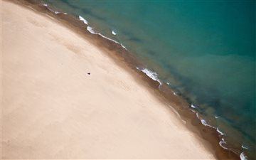 Drone view of sand shorel... Mac wallpaper