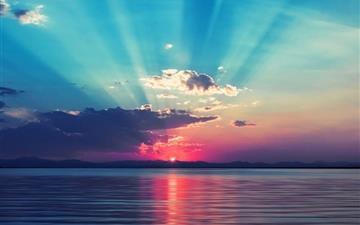 Sunrise at sea Mac wallpaper