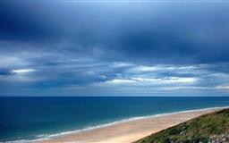 Dark Sky Over A Blue Sea Mac wallpaper