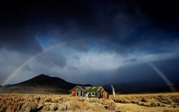 Abandoned House Under Rainbow