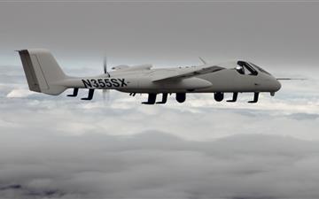 Airplane Above Clouds Mac wallpaper