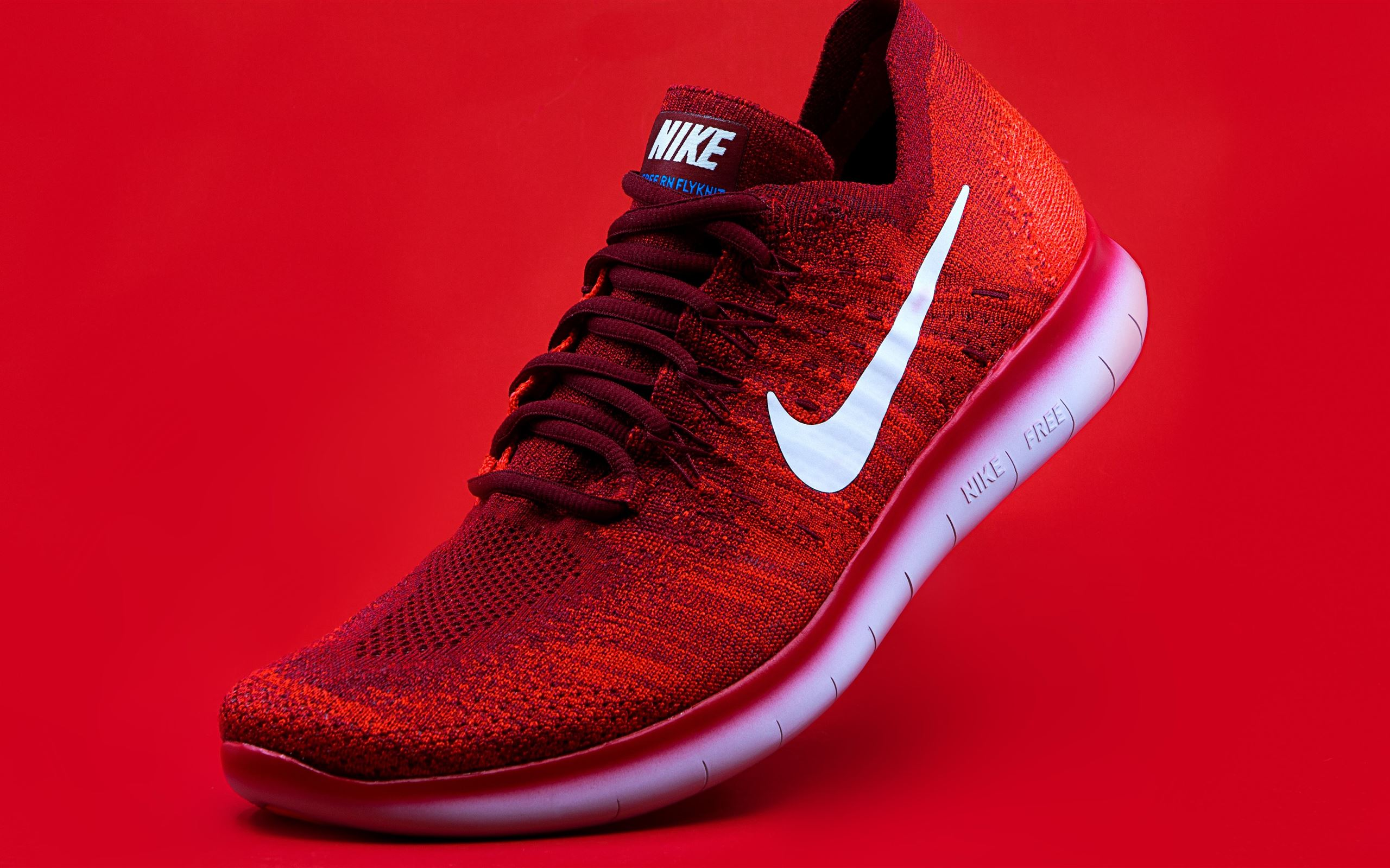 unpaired red Nike sneaker Mac Wallpaper