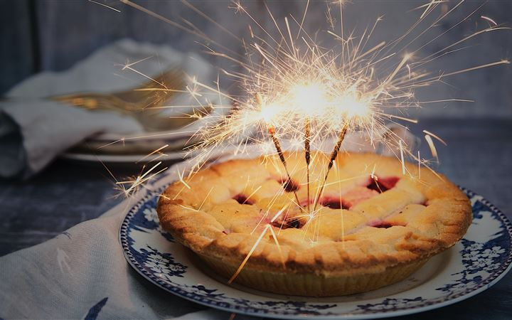 brown pie with sparklers on top iMac wallpaper
