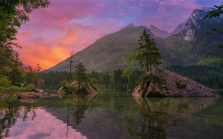 green trees near lake and mountain during sunset iMac wallpaper