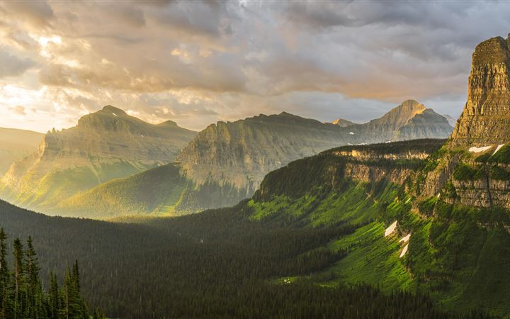 stormy sunrise at glacier national park 8k iMac wallpaper