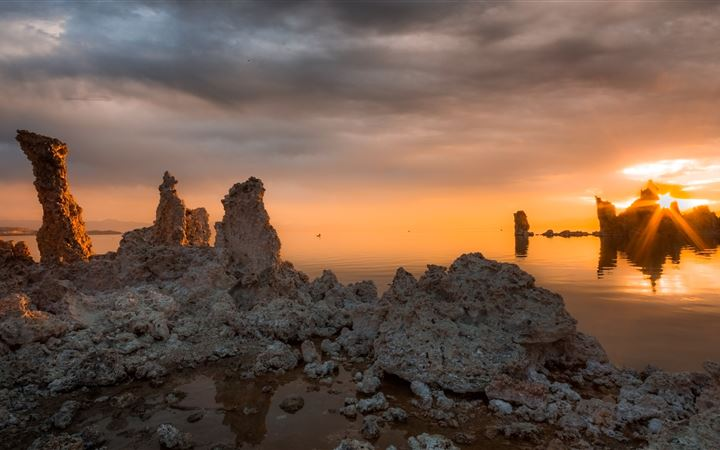 landscape photography of pile of rocks under a dra All Mac wallpaper