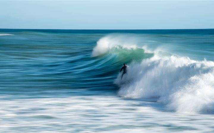 person riding surfboard All Mac wallpaper