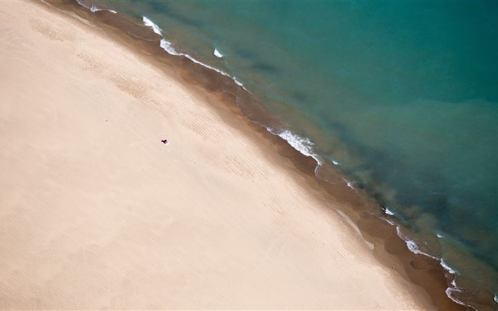 Drone view of sand shorel... All Mac wallpaper
