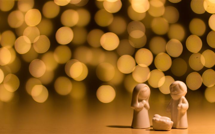 shallow focus photo of the Nativity figurine MacBook Air wallpaper