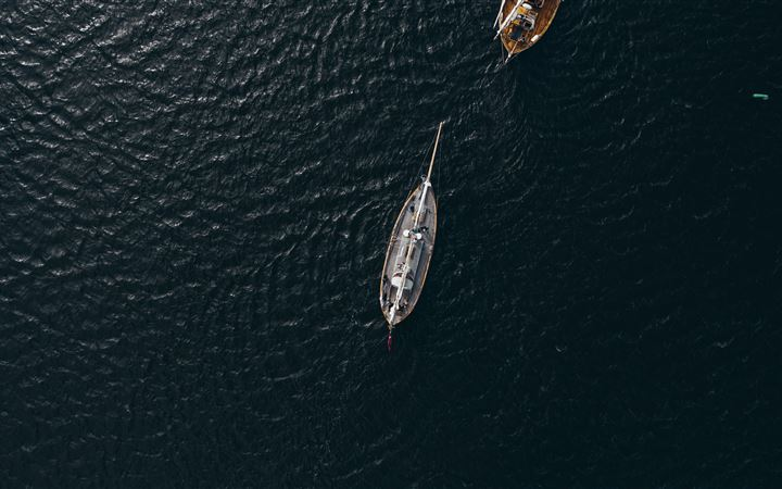 aerial view of white boat on body of water during MacBook Pro wallpaper
