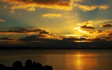 Sunset Hiding Behind The Clouds Mac wallpaper