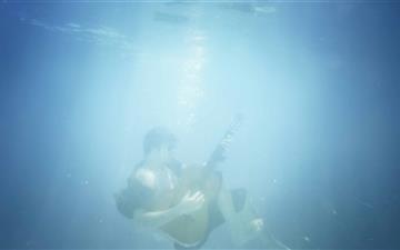 Playing Guitar Underwater Mac wallpaper