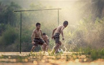 Asian Kids Playing Soccer Mac wallpaper
