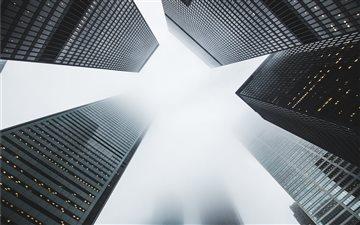 Foggy skyscrapers Mac wallpaper