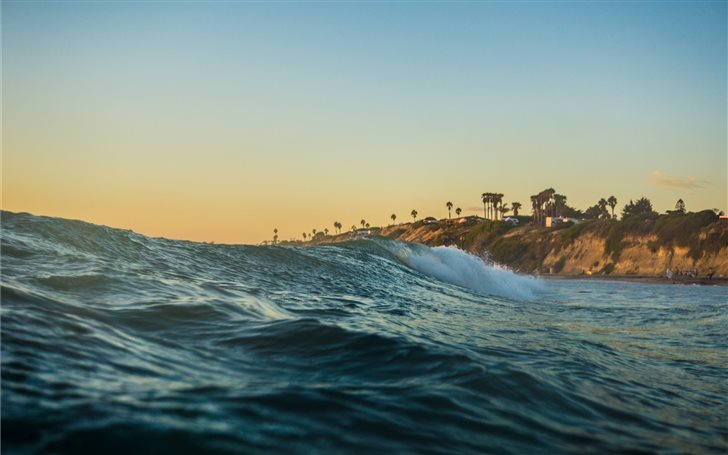 Ocean waves on a beach Mac Wallpaper