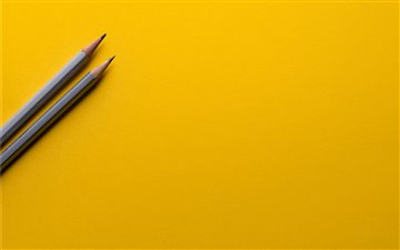 Minimal pencils on yellow iMac wallpaper