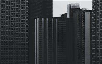 Gloomy urban buildings Mac wallpaper