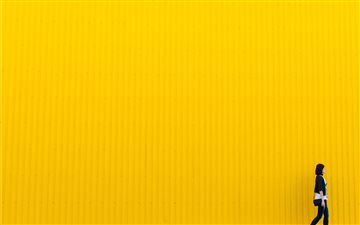 Yellow wall Mac wallpaper