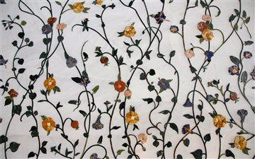 Flowers on a wall Mac wallpaper