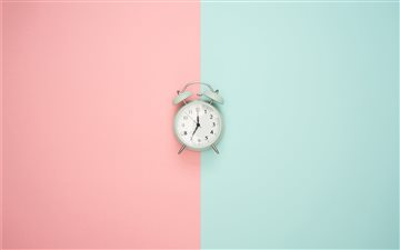 Blue clock on a pastel ba... iMac wallpaper