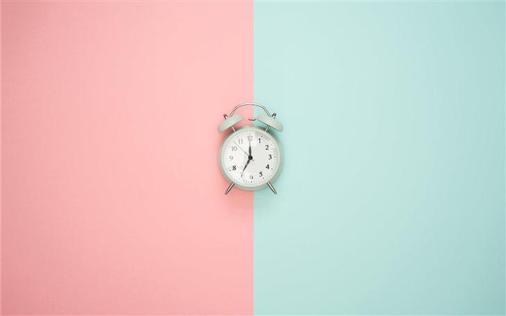 Blue clock on a pastel ba... Mac Wallpaper
