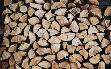 Wood pile in a shack iMac wallpaper