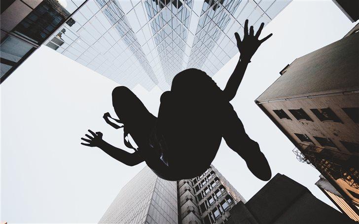 silhouette of person jump... Mac Wallpaper