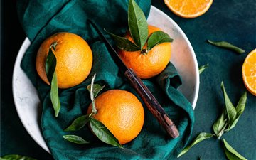 Clementines with leaves Mac wallpaper