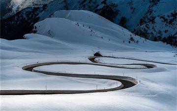 road in between snows Mac wallpaper