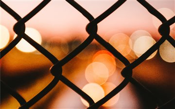Bokeh behind a fence Mac wallpaper