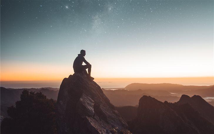 silhouette of person sitt... Mac Wallpaper