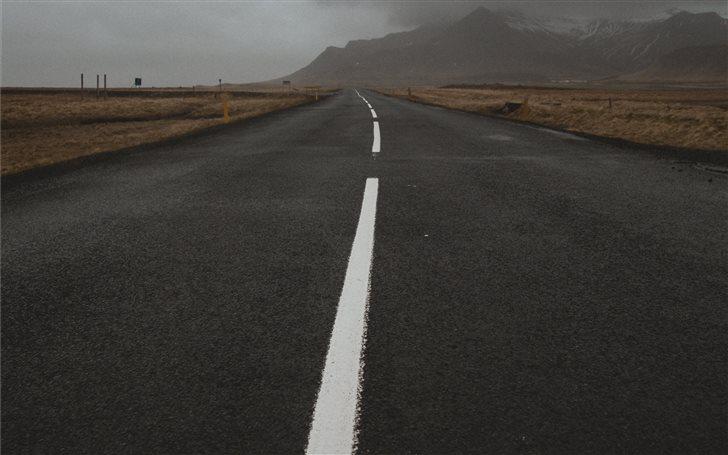 empty concrete road durin... Mac Wallpaper