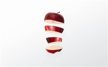 Sliced apple Mac wallpaper