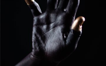 Black space palm hand wit... Mac wallpaper