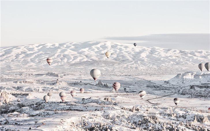 assorted color air balloons below snowland at dayt Mac Wallpaper