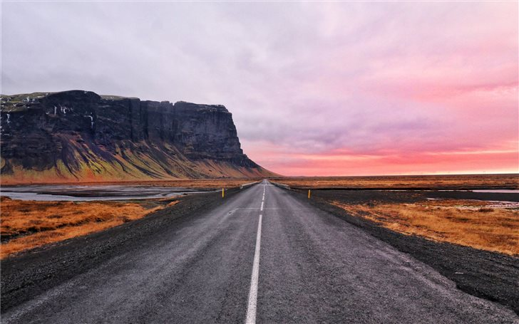 asphalt road and cliff horizon Mac Wallpaper
