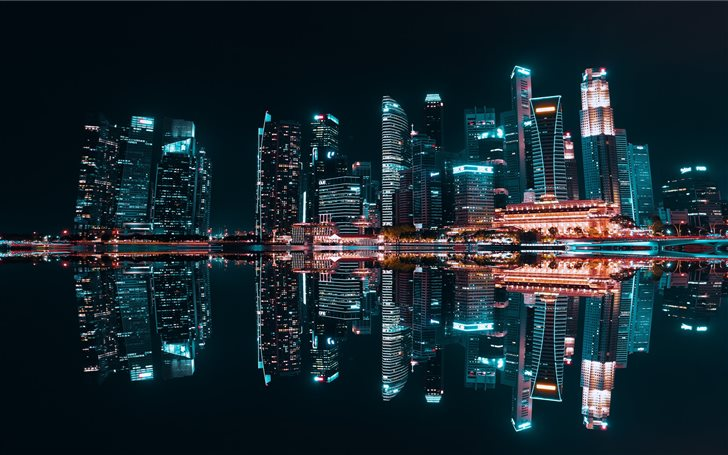 lighted buildings during night time Mac Wallpaper