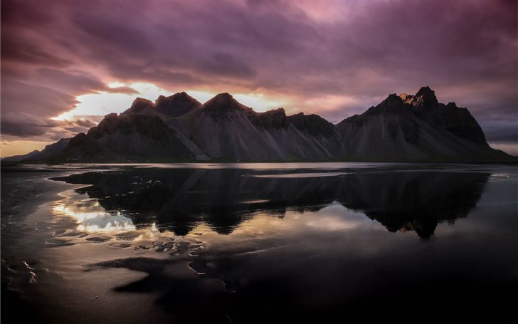 mountains reflecting on body of water Mac Wallpaper